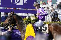 Pierre-Charles Boudot, celebrates after riding Order of Australia to win the Breeders' Cup Mile horse race at Keeneland Race Course, in Lexington, Ky., Saturday, Nov. 7, 2020. (AP Photo/Michael Conroy)