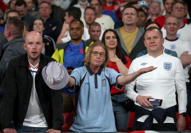 England fans react in the stands after Italy's Bonucci's equaliser