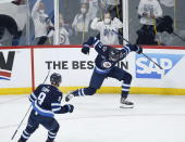 Winnipeg Jets' Adam Lowry (17) celebrates his goal against the Montreal Canadiens with Andrew Copp (9) during the first period of Game 1 of an NHL hockey Stanley Cup second-round playoff series Wednesday, June 2, 2021, in Winnipeg, Manitoba. (John Woods/The Canadian Press via AP)