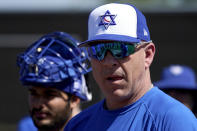 FILE - Israel Olympic baseball manager Eric Holtz watches his team practice at Salt River Fields spring training facility in Scottsdale, Ariz., in this Wednesday, May 12, 2021, file photo. Major League Baseball refused to allow players on 40-man rosters to participate in the six-nation Olympic tournament. Israel lost catcher Ryan Lavarnway when the Indians brought him up from Triple-A Columbus in late June after Austin Hedges went on the concussion injured list. Israel manager Eric Holtz, already without Baltimore pitcher Dean Kremer, was hoping to get Lavarnway back because his team's opener against the United States on July 30. (AP Photo/Matt York, File)