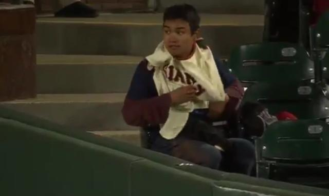This fan of the Giants or the Diamondbacks kept switching jerseys every half inning to increase his chances of getting a souvenir baseball. (Twitter/@FOXSPORTSAZ)