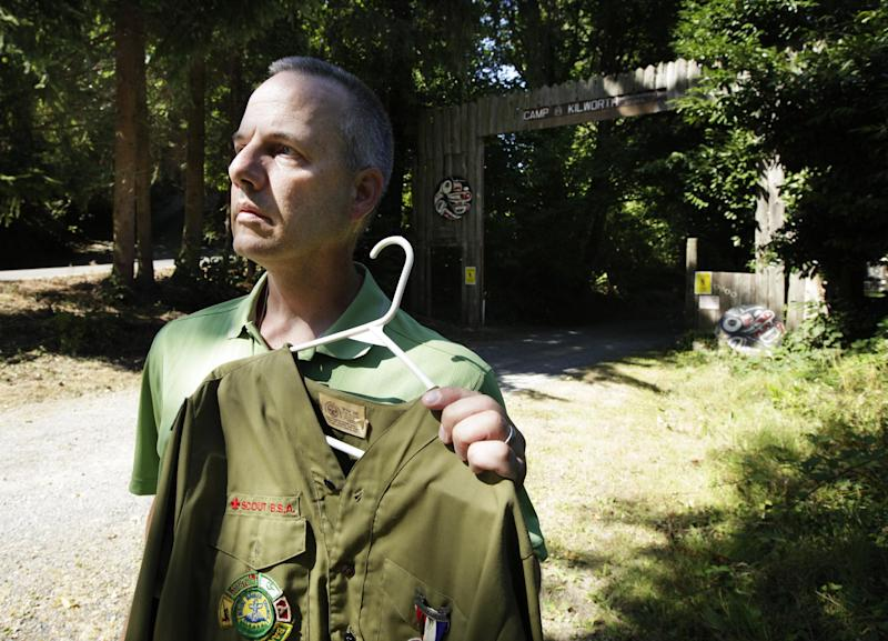 "In this Thursday, Aug. 16, 2012 photo, Boy Scout abuse victim Tom Stewart poses for a photo with his old Scout uniform outside the Boy Scout Camp Kilworth in Federal Way, Wash. Former Boy Scouts still struggle to cope with the abuse they suffered at the hands of Scout leaders, and those who are willing to tell the stories of their abuse have come to feel abandoned by an organization considered a pillar of American society. ""There are so many victims who have suffered in silence. Marriages and relationships with their kids have suffered,"" said Stewart, a 46-year-old engineer for Boeing. (AP Photo/Ted S. Warren)"
