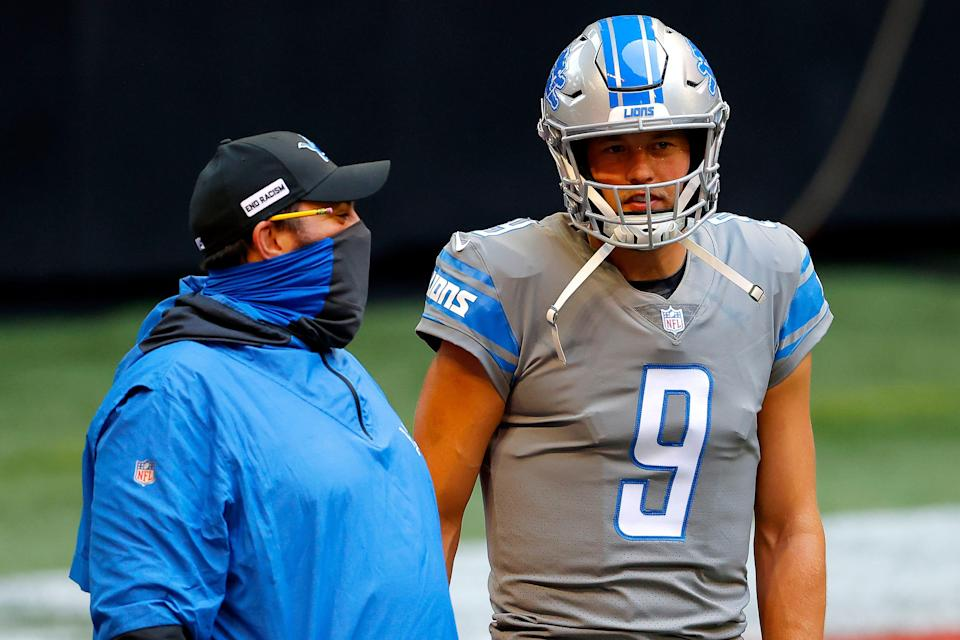 Lions coach Matt Patricia and quarterback Matthew Stafford look on during warmups before the Lions' 23-22 win on Sunday, Oct. 25, 2020, in Atlanta.