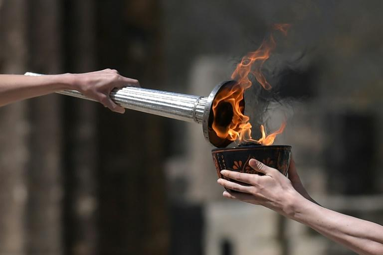 The torch relay will go ahead as planned but some festivities are scaled back