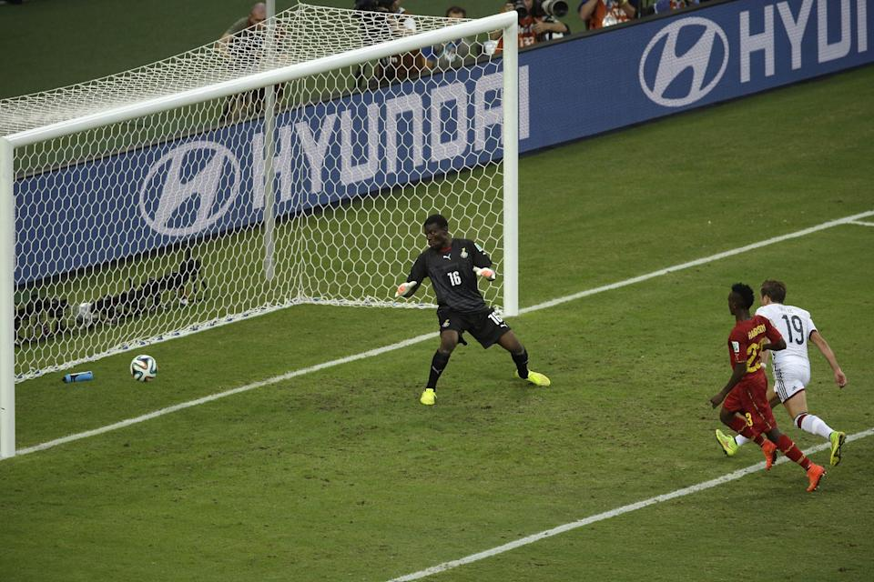 Germany's Mario Goetze, right, scores the opening goal past Ghana's goalkeeper Fatawu Dauda, left, during the group G World Cup soccer match between Germany and Ghana at the Arena Castelao in Fortaleza, Brazil, Saturday, June 21, 2014. (AP Photo/Themba Hadebe)