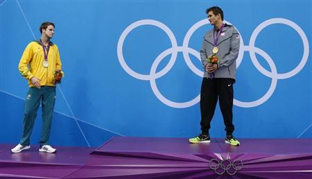 Medallists stand on podium during the men's 100m freestyle victory ceremony at the London 2012 Olympic Games