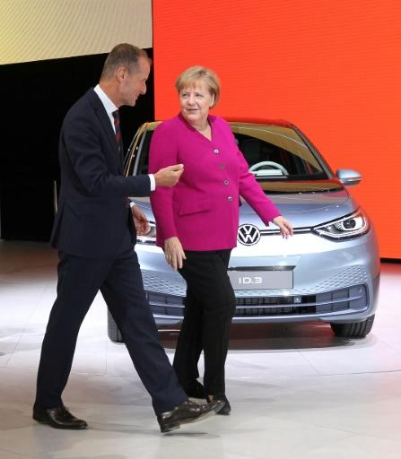 Merkel with Volkswagen CEO Herbert Diess in front of the auto company's ID.3 electric car at the IAA Car Show in Frankfurt this month