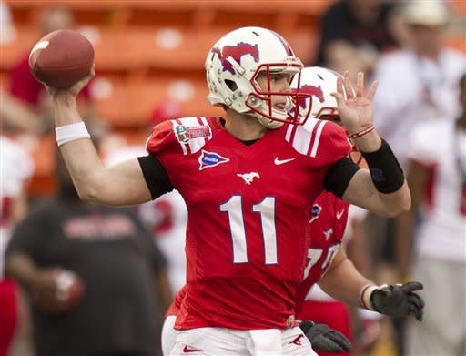 SMU quarterback Garrett Gilbert drops back to pass against Fresno State in the third quarter of the Hawaii Bowl, an NCAA college football game Monday, Dec. 24, 2012, in Honolulu. (AP Photo/Eugene Tanner)
