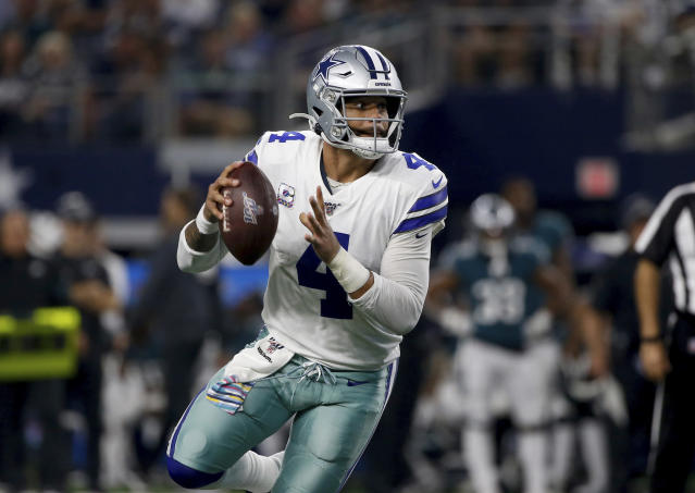 Dallas Cowboys quarterback Dak Prescott (4) runs the ball and reaches the end zone for a touchdown against the Philadelphia Eagles in the second half of an NFL football game in Arlington, Texas, Sunday, Oct. 20, 2019. (AP Photo/Ron Jenkins)