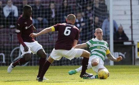 Britain Football Soccer - Heart of Midlothian v Celtic - Scottish Premiership - Tynecastle - 2/4/17 Celtic's Scott Brown in action with Hearts' Perry Kitchen Reuters / Russell Cheyne Livepic