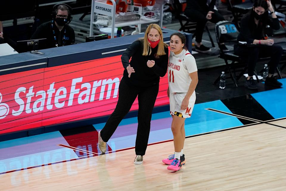 Maryland coach Brenda Frese talks with Katie Benzan during the first half of the women's championship game against Iowa at the Big Ten Conference tournament.