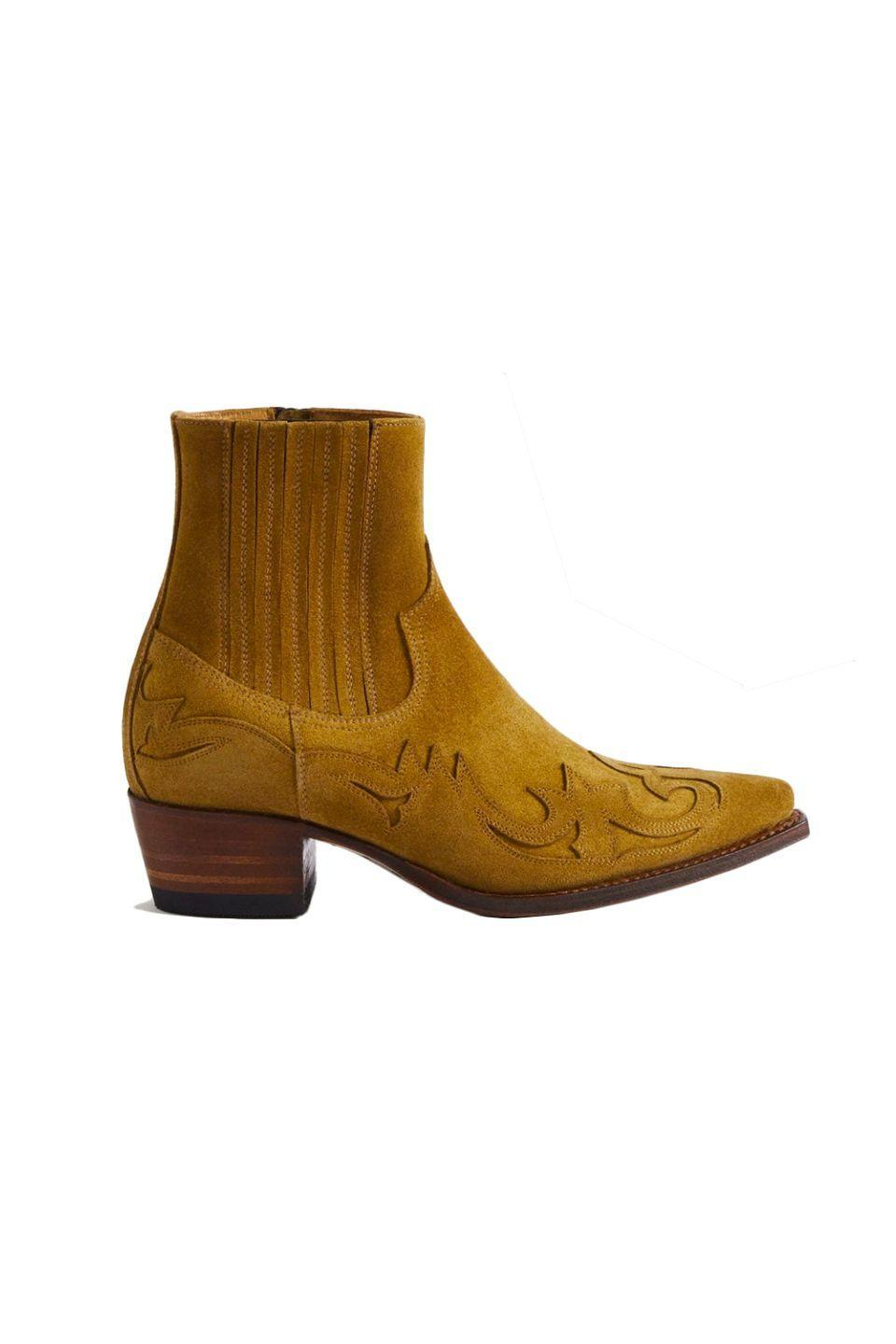 """<p><a class=""""link rapid-noclick-resp"""" href=""""https://go.redirectingat.com?id=127X1599956&url=https%3A%2F%2Fshop.mango.com%2Fgb%2Fwomen%2Fshoes-leather%2Fgoodyear-welted-leather-boots_87092022.html&sref=https%3A%2F%2Fwww.harpersbazaar.com%2Fuk%2Ffashion%2Fwhat-to-wear%2Fg18720504%2Fbest-cowboy-boots%2F"""" rel=""""nofollow noopener"""" target=""""_blank"""" data-ylk=""""slk:SHOP NOW"""">SHOP NOW</a></p><p>Mango's premium boots are Goodyear welted (a process which ensures water resistance and better temperature regulation), so they'll last you. The hand-stitched appliqué and panelled sock detailing are a modern update on classic western footwear. </p><p>Goodyear welted leather boots, £299, mango.com</p>"""
