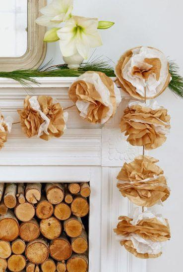 "<p>You really can use anything to make pretty DIY Christmas decorations if you know where to look. This mock floral garland is made out of coffee filters. If you don't have any of those lying around, use tissue paper and make an afternoon of it. Get the tutorial from <a href=""https://www.countryliving.com/diy-crafts/how-to/g1798/recycled-crafts-holiday-decor/?slide=6"" rel=""nofollow noopener"" target=""_blank"" data-ylk=""slk:Country Living"" class=""link rapid-noclick-resp"">Country Living</a>.</p>"
