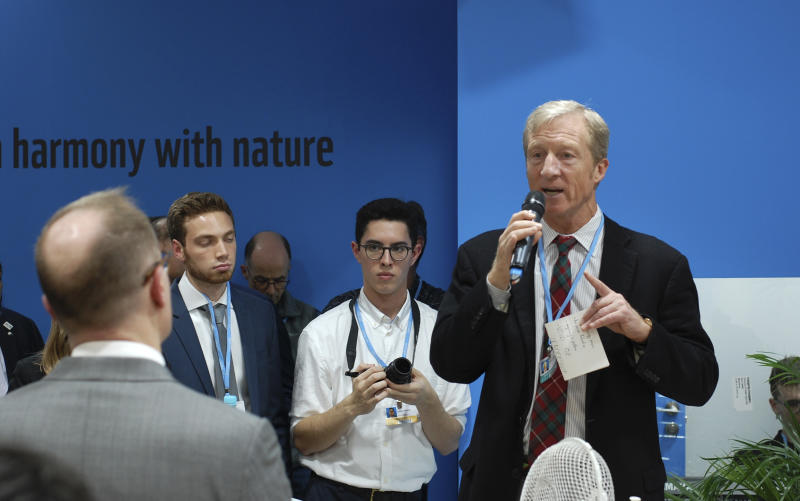 Billionaire Democrat Tom Steyer speaks during a reception at the U.S. Climate Action Center inside the COP24 global climate talks in Katowice, Poland, on Friday, Dec. 7, 2018. (AP Photos/Frank Jordans)