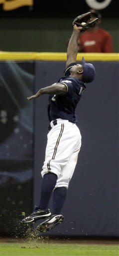 Milwaukee Brewers' Nyjer Morgan makes a leaping catch on a ball hit by Houston Astros' Jose Altuve during the ninth inning of a baseball game Tuesday, April 24, 2012, in Milwaukee. The Brewers won 9-6. (AP Photo/Morry Gash)
