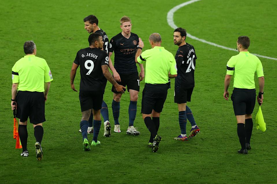 De Bruyne remonstrates with referee Mike Dean after City's would-be equaliser was chalked off (Tottenham Hotspur FC via Getty I)