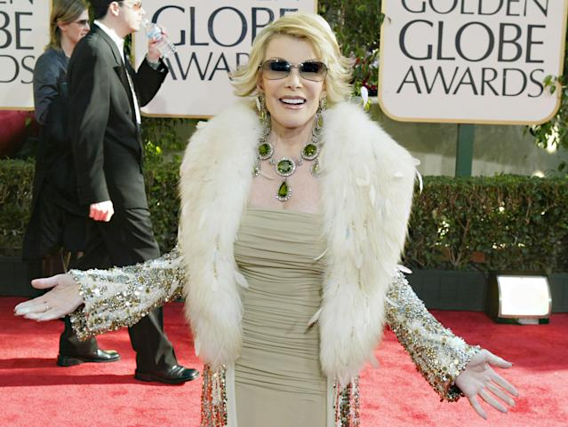 Joan Rivers, who died in 2014, was a roast-comic-turned-red-carpet mainstay who pioneered the hit show <em>Fashion Police</em>, which ended in 2017. (Photo: Getty Images)