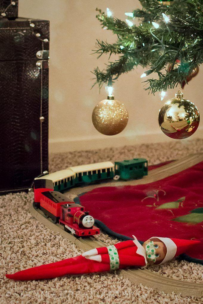 """<p>Quick! Tell your kids they've got to save the Elf—he's about to be run over by a train!</p><p><strong>Get the tutorial at <a href=""""https://californiaunpublished.com/45-amazingly-easy-elf-on-the-shelf-ideas-for-busy-moms/"""" rel=""""nofollow noopener"""" target=""""_blank"""" data-ylk=""""slk:California Unpublished"""" class=""""link rapid-noclick-resp"""">California Unpublished</a>.</strong> </p>"""