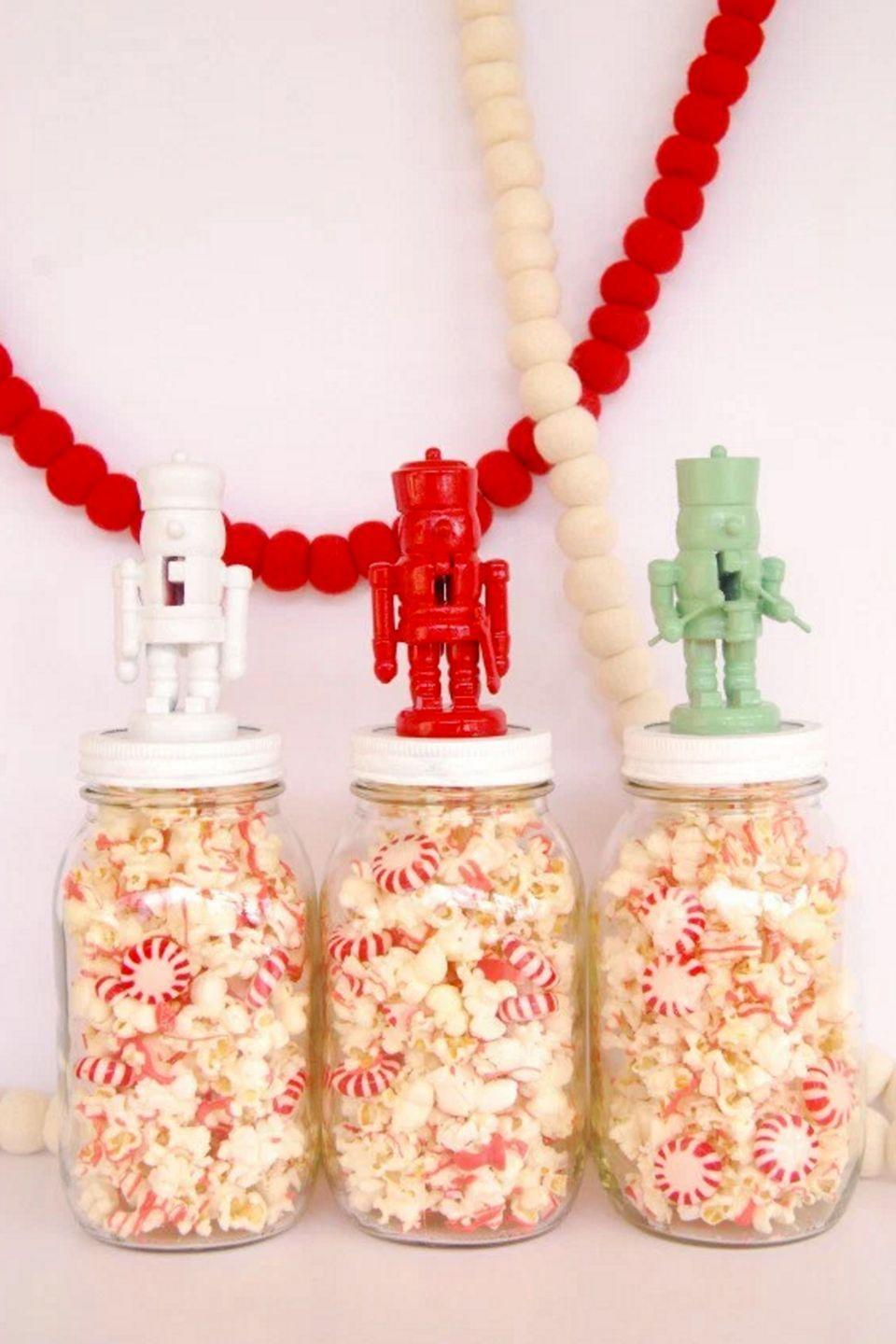 """<p>Having a Christmas party? Set these treat-filled jars out around your home for a festive snack that also doubles as decor. To make them, blogger Lexy Ward snagged some mini nutcrackers, spray-painted them, then glued them to the tops of her Mason jars. </p><p><strong>Get the tutorial at <a href=""""http://theproperpinwheel.com/2012/12/diy-nutcracker-jar-toppers/"""" rel=""""nofollow noopener"""" target=""""_blank"""" data-ylk=""""slk:The Proper Pinwheel"""" class=""""link rapid-noclick-resp"""">The Proper Pinwheel</a>.</strong></p><p><a class=""""link rapid-noclick-resp"""" href=""""https://www.amazon.com/Krylon-GIDDS-800181-Spray-Paint-Cherry/dp/B0009X8M12/?tag=syn-yahoo-20&ascsubtag=%5Bartid%7C10050.g.2132%5Bsrc%7Cyahoo-us"""" rel=""""nofollow noopener"""" target=""""_blank"""" data-ylk=""""slk:SHOP SPRAY PAINT"""">SHOP SPRAY PAINT</a></p>"""