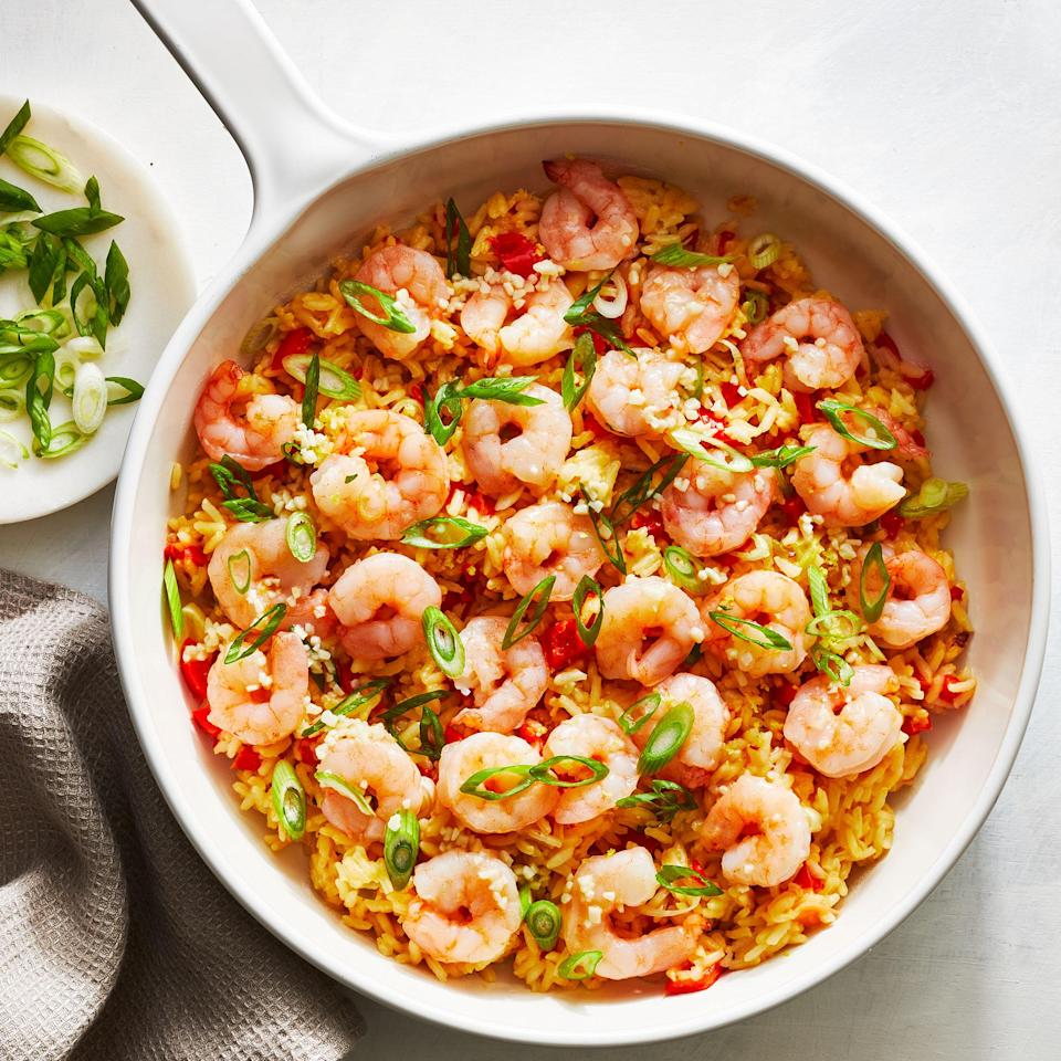 """<p>This one-pan garlicky shrimp and rice dish makes a great easy dinner with easy cleanup. The garlic mellows as it cooks and infuses its flavor into the sweet shrimp and rice in the pan. A squeeze of lemon at the end brightens up the dish.</p> <p> <a href=""""https://www.eatingwell.com/recipe/7892610/one-pan-garlicky-shrimp-rice/"""" rel=""""nofollow noopener"""" target=""""_blank"""" data-ylk=""""slk:View recipe"""" class=""""link rapid-noclick-resp""""> View recipe </a></p>"""