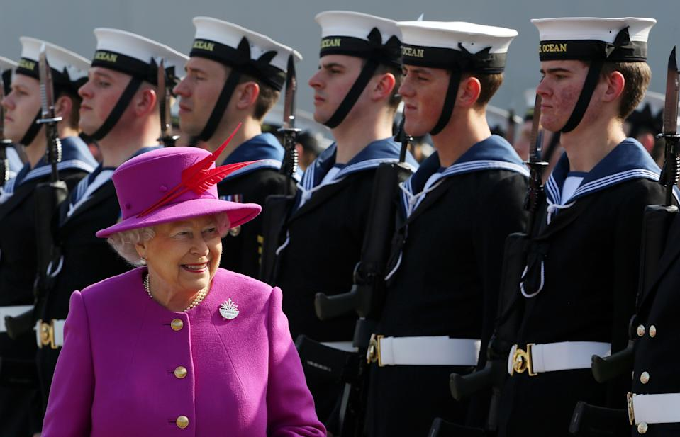 Britain's Queen Elizabeth II inspects the Guard of Honour as she arrives for a visit of the Royal Navy's HMS Ocean at Her Majesty's Naval Base Devonport, Plymouth, south west England, on March 20, 2015. HMS Ocean is an amphibious assault ship and helicopter carrier. AFP PHOTO / POOL / GEOFF CADDICK