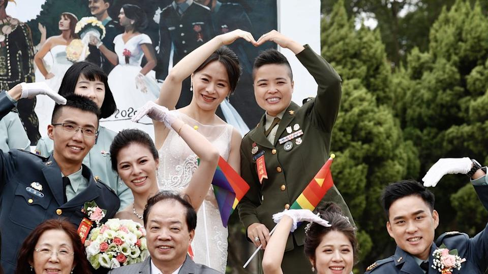 Couple Yi Wang (R) and Yumi Meng (L) react during a military mass wedding in Taoyuan, Taiwan, 30 October 2020