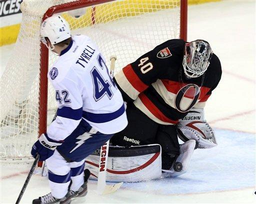 Ottawa Senators goaltender Robin Lehner blocks a shot by Tampa Bay Lightning winger Dana Tyrell (42) during the second period of their NHL hockey game in Ottawa, Ontario, Saturday, March 23, 2013. (AP Photo/The Canadian Press, Fred Chartrand)