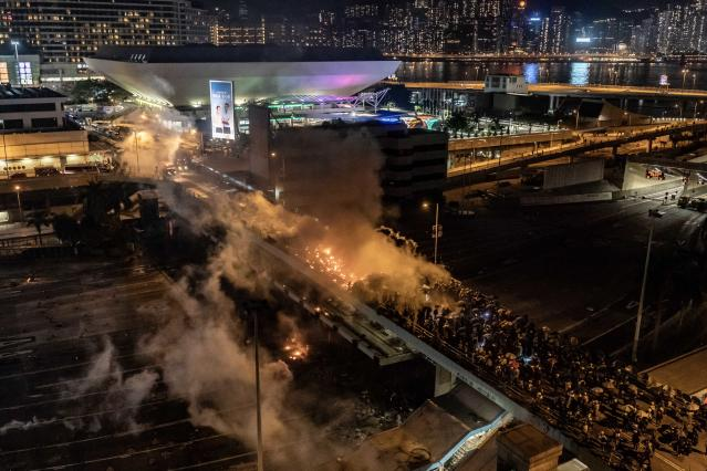 Protesters and police clash as on a bridge at The Hong Kong Poytechnic University on Nov. 17, 2019 in Hong Kong, China. (Photo: Anthony Kwan/Getty Images)
