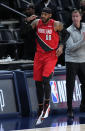Portland Trail Blazers forward Carmelo Anthony (00) celebrates a 3-point basket against the Denver Nuggets during the first half of Game 1 of a first-round NBA basketball playoff series Saturday, May 22, 2021, in Denver. (AP Photo/Jack Dempsey)