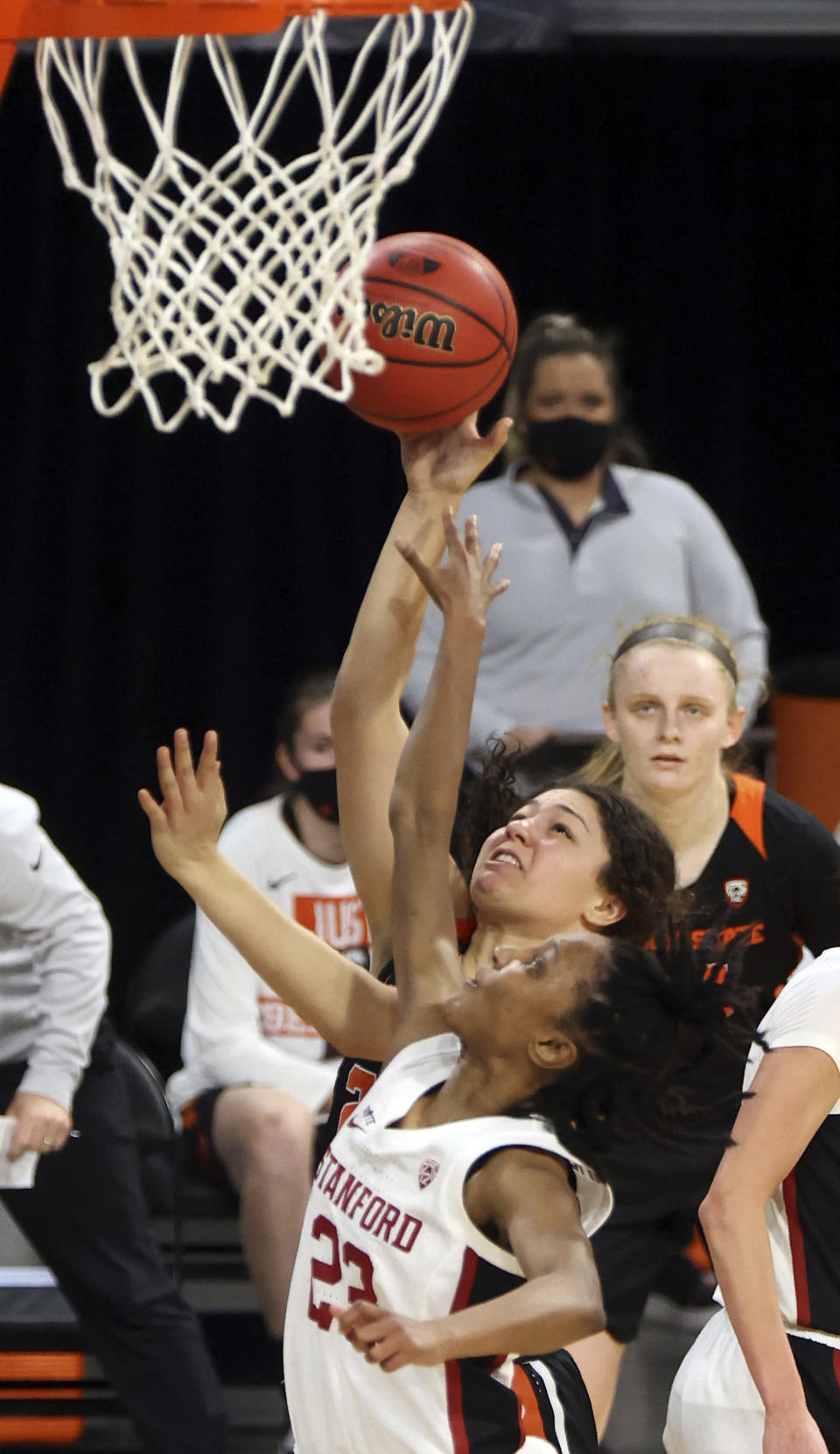 Oregon State guard Talia Von Oelhoffen (22) shoots as Stanford guard Kiana Williams (23) defends during the second half of an NCAA college basketball game in the semifinal round of the Pac-12 women's tournament Friday, March 5, 2021, in Las Vegas. (AP Photo/Isaac Brekken)