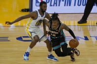 Memphis Grizzlies guard Ja Morant, right, is defended by Golden State Warriors forward Andrew Wiggins during the first half of an NBA basketball game in San Francisco, Sunday, May 16, 2021. (AP Photo/Jeff Chiu)