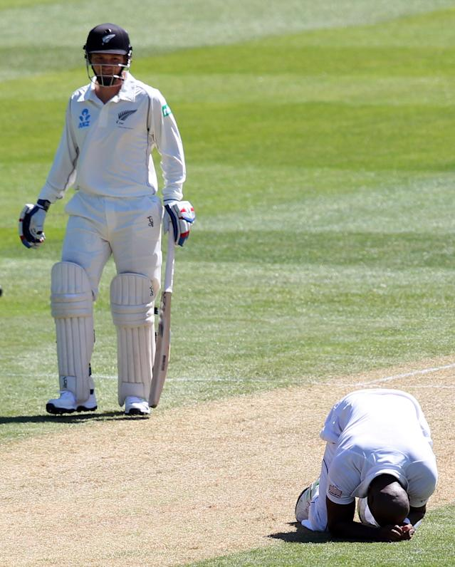 DUNEDIN, NEW ZEALAND - DECEMBER 04: Tino Best of the West Indies reacts after seeing a dropped catch off his bowling during day two of the first test match between New Zealand and the West Indies at University Oval on December 4, 2013 in Dunedin, New Zealand. (Photo by Rob Jefferies/Getty Images)