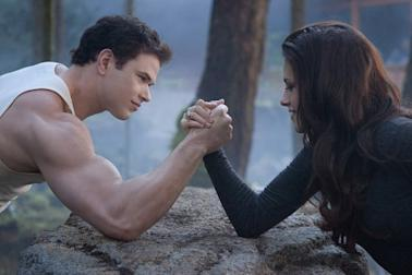 Emmet, left, and Bella arm wrestle in 'The Twilight Saga: Breaking Dawn - Part 2'