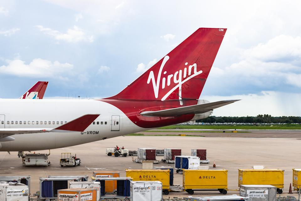 ORLANDO, FLORIDA, UNITED STATES - 2019/07/19: The 'Virgin' branding in the tail of a large commercial plane. The marking belongs to the Virgin Atlantic British airline. The plane is seen in the Orlando airport. (Photo by Roberto Machado Noa/LightRocket via Getty Images)