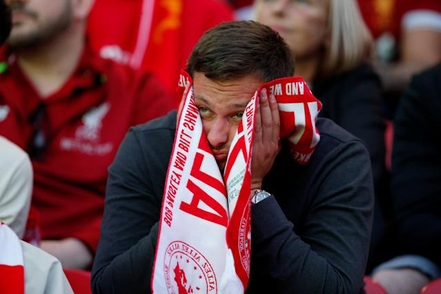 Soccer Football - Liverpool fans watch the Champions League Final - Liverpool, Britain - May 26, 2018 Liverpool fan reacts inside Anfield REUTERS/Andrew Yates