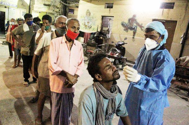 PHOTO: A health worker collects nasal swab samples from homeless people for corona virus Rapid Antigen Testing in New Delhi, India, Sept. 22, 2020. (NurPhoto via Getty Images)
