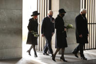Camilla, Duchess of Cornwall, left, and Britain's Prince Charles, Prince of Wales, German President Frank-Walter Steinmeier, left, and his wife Elke Buedenbender arrive to pay their respect during a wreath laying ceremony on national Memorial Day at the Neue Wache in Berlin, on Nov. 15, 2020. The royals are in the German capital for a wreath laying ceremony on national Memorial Day at Neue Wache and a visit to parliament on November 15, 2020. ( Odd Andersen / Pool via AP)