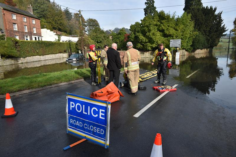 Members of Gloucestershire Fire & Rescue Service, in Lower Lydbrook, Gloucestershire, as they prepare to enter flood water from the River Wye which has flooded parts of the village. (Photo by Ben Birchall/PA Images via Getty Images)