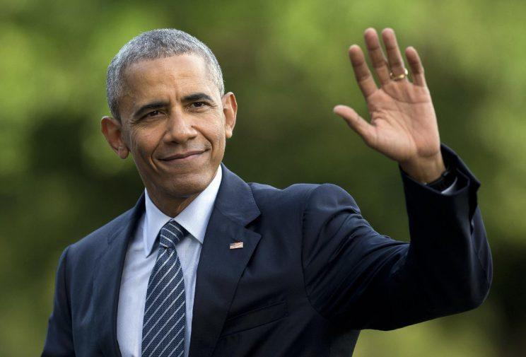 President Obama waves as he walks across the south lawn of the White House. (Carolyn Kaster/AP/File)