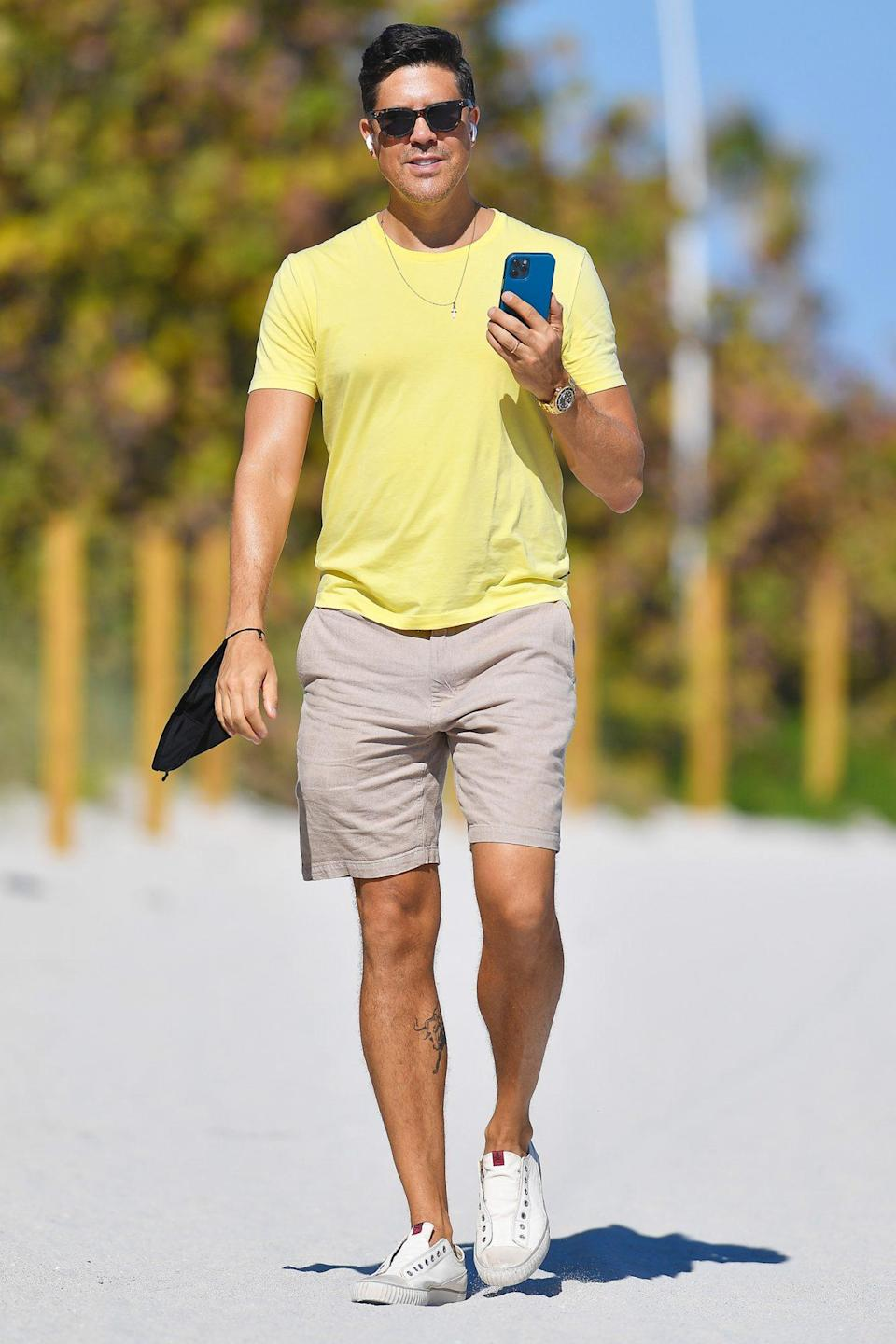 <p><em>Million Dollar Listing</em>'s Fredrik Eklund talks on his phone during a stroll in Miami over the weekend.</p>