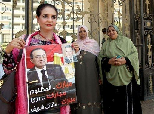 People gather outside the hospital where Hosni Mubarak is in a coma