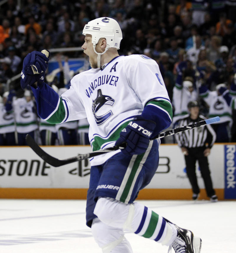 Vancouver Canucks defenseman Sami Salo, of Finland, celebrates his second goal against the San Jose Sharks during the second period of Game 4 of the NHL hockey Stanley Cup playoffs Western Conference finals in San Jose, Calif., Sunday, May 22, 2011. (AP Photo/Marcio Jose Sanchez)