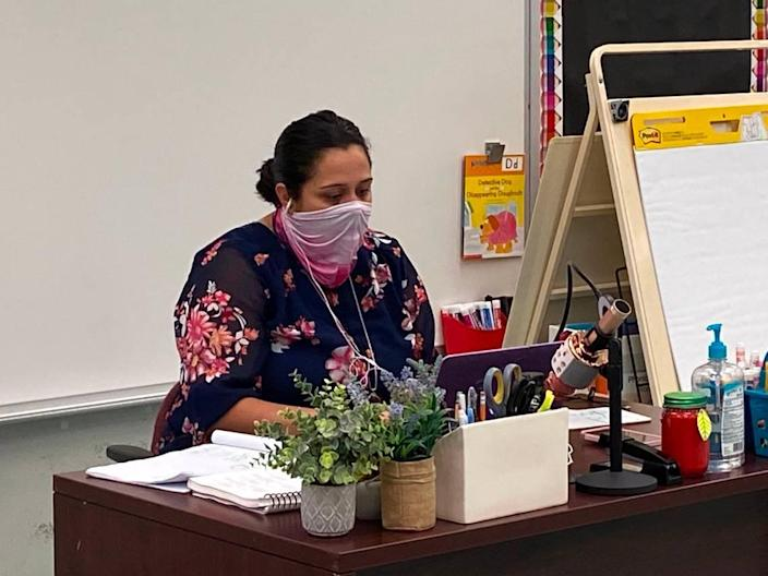 Yassy Comas teaches her kindergarten class both online and in person on Friday, Oct. 9, 2020, at Broward Estates Elementary School.