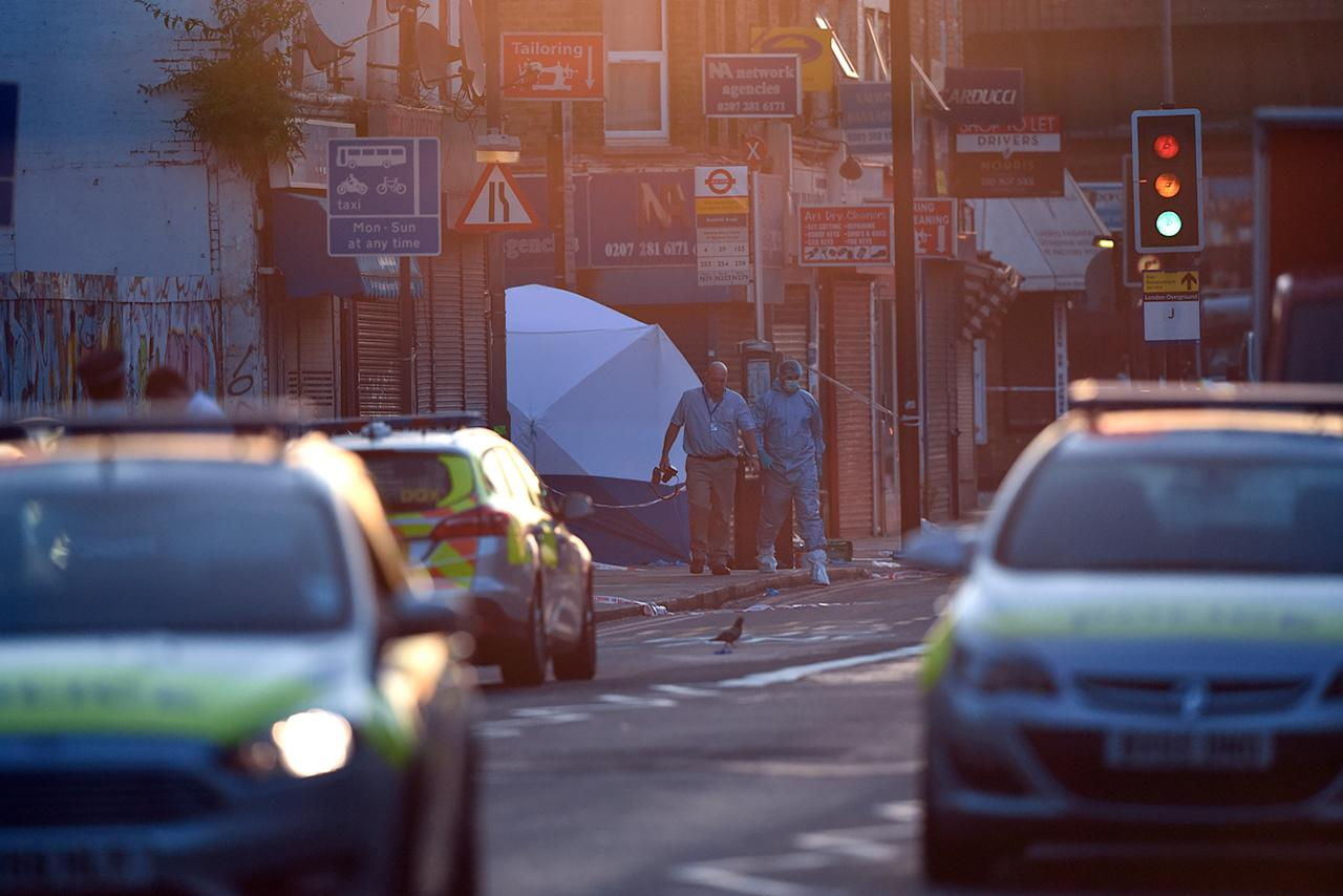 <p>A police forensics officer walks from the scene where a van is believed to have been involved in an incident near Finsbury Park Mosque in which the van ploughed into pedestrians, on June 19, 2017, in London, England. (Photo: Carl Court/Getty Images) </p>