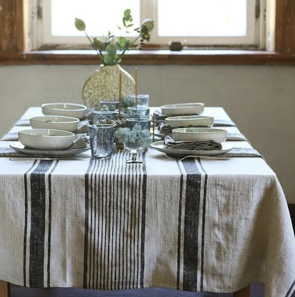 "<p>hudsonandvine.com</p><p><strong>$90.00</strong></p><p><a href=""https://hudsonandvine.com/products/black-linen-provence-tablecloth"" rel=""nofollow noopener"" target=""_blank"" data-ylk=""slk:Shop Now"" class=""link rapid-noclick-resp"">Shop Now</a></p><p>This striped linen tablecloth will add a French rustic flair to your Thanksgiving table. Made from 100% linen, this fabric is machine-washable and will get softer over time.</p>"