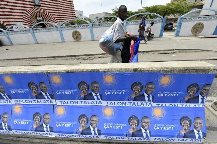 Talon, seen here with his running mate Mariam Talata on campaign posters in Cotonou, is expected to win on Sunday