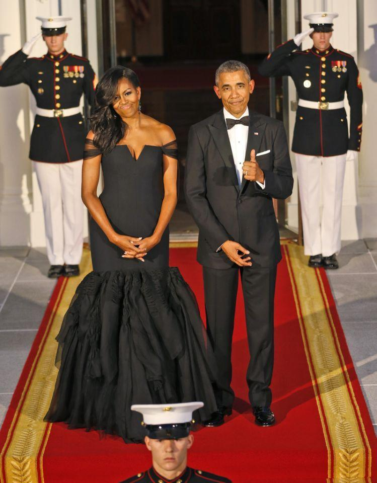 """<p>To host Chinese President Xi Jinping, Obama called on Vera Wang to make her black mermaid gown, which was fitted on the top and featured an organza trumpet skirt. """"It is such a privilege, as an American of Chinese heritage, to have dressed First Lady @<a rel=""""nofollow noopener"""" href=""""https://twitter.com/MichelleObama"""" target=""""_blank"""" data-ylk=""""slk:MichelleObama"""" class=""""link rapid-noclick-resp"""">MichelleObama</a> for this state dinner honoring President Xi Jinping and First Lady Peng Liyuan, of the People's Rebublic of China,"""" <a rel=""""nofollow"""" href=""""https://www.yahoo.com/style/michelle-obama-vera-wang-absolute-020144801.html"""" data-ylk=""""slk:Wang tweeted;outcm:mb_qualified_link;_E:mb_qualified_link;ct:story;"""" class=""""link rapid-noclick-resp yahoo-link"""">Wang tweeted</a>.<br></p>"""