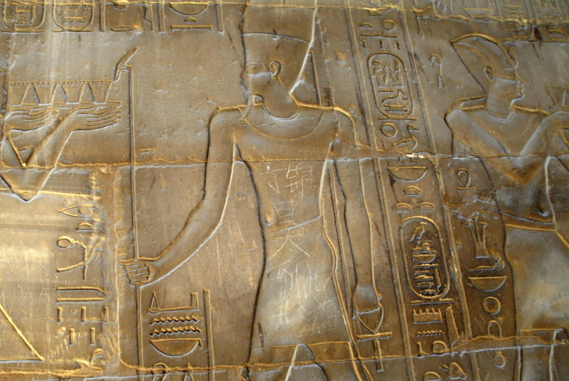 "In this photo taken Monday May 6, 2013, the Chinese words ""Ding Jinhao visited here"" is seen on bas-relief in the 3,500-year-old Luxor temple in Luxor, Egypt.  A Chinese teenager who defaced the ancient temple in Egypt with graffiti has come under fire at home where his vandalism prompted public fretting about how to cultivate a good image overseas as more newly affluent Chinese travel abroad.(AP Photo) CHINA OUT"