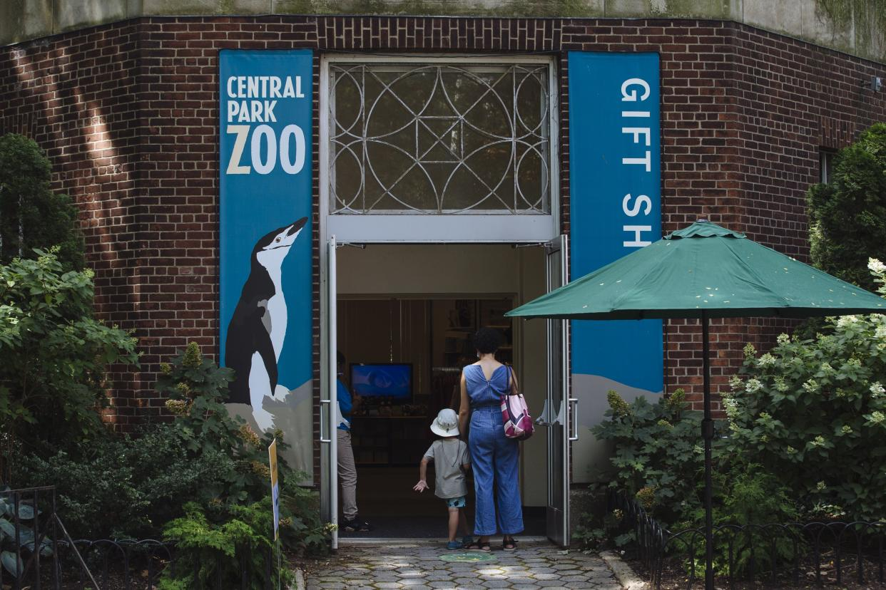 People enter the Central Park Zoo which reopened to members with timed tickets today in Manhattan, New York on Monday, July 20, 2020.