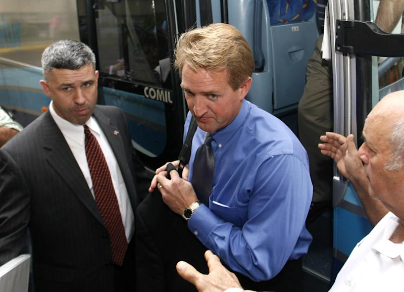 FILE - In this Dec. 15, 2006, file photo Rep. Jeff Flake, R-Ariz, center, arrives at a Havana, Cuba, hotel, one in a delegation of U.S. lawmakers following leadership shifts there, and possibilities for change in U.S. policies towards the Island. In Flake's re-election race both a GOP primary opponent and Democrats are the six-term congressman as a Washington insider, because he worked as a lobbyist 20 years ago for a Namibian uranium operation with ties to Iran. Flake says he's long opposed unilateral penalties like sanctions, whether against Iran, Sudan, Cuba, Myanmar or any country, because he saw the damage sanctions can have on innocent people during his time in Nambia. (AP Photo/ Javier Galeano, File)